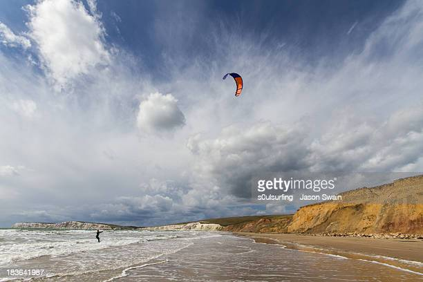 kitesurfing at compton bay, isle of wight - isle of wight stock photos and pictures