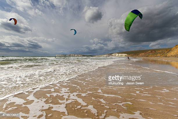kitesurfing at compton bay, isle of wight - compton bay isle of wight stock pictures, royalty-free photos & images
