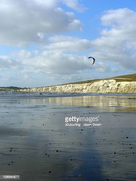 kitesurfing at compton bay - compton bay isle of wight stock pictures, royalty-free photos & images