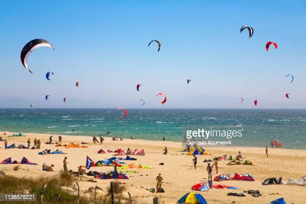 kitesurfing in valdevaqueros beach in cadiz - tarifa stock pictures, royalty-free photos & images
