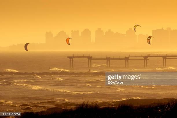 kitesurfing near by la barra beach, near punta del este, uruguay - maldonado uruguay stock pictures, royalty-free photos & images