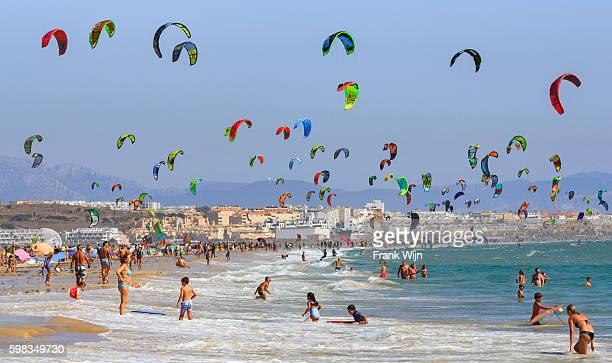 kitesurfing on tarifa beach - tarifa stock photos and pictures