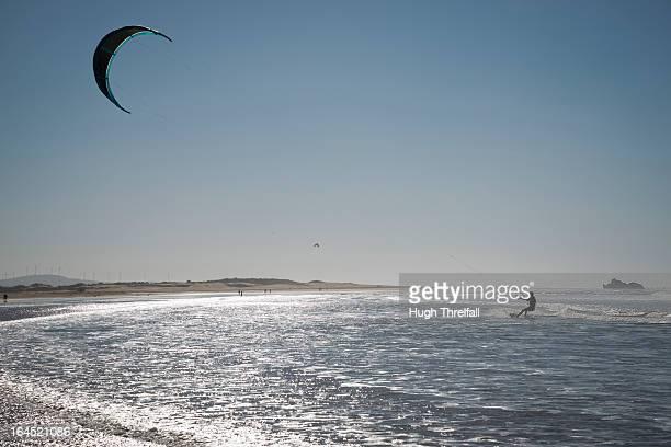 kitesurfing or kiteboarding in essaouira - hugh threlfall stock pictures, royalty-free photos & images