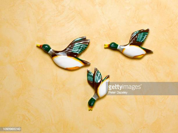 kitsch retro flying duck ornaments - failure stock pictures, royalty-free photos & images