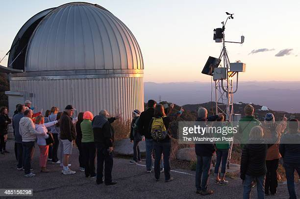 Kitt Peak National Observatory Arizona Participants in a nightly observation program watch sunset from a ridge on the 6880foot Kitt Peak The roughly...