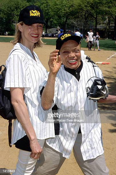 Kitt Shapiro and her mother Eartha Kitt play for their softball team The Wild Party May 4 2000 on a field in Central Park in New York City during...