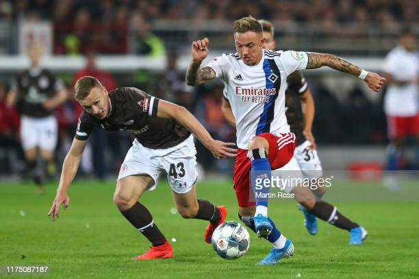 Kittel Sonny of Hamburg and Sebastian Ohlsson of FC St. Pauli battle for possession during the Second Bundesliga match between FC St. Pauli and...