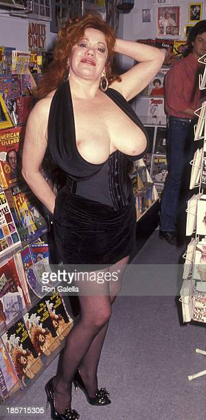 Kitten Natividad attends the party for A Handbook For Heels on March 28 1992 at the Golden Apple Book Store in Hollywood California