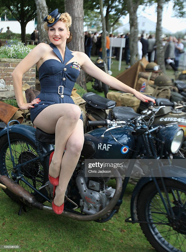 Kitten Von Mew poses for a photograph on a vintage RAF bike during Goodwood Revival 2010 at Goodwood on September 17, 2010 in Chichester, England. The event is based around a classic car race meeting and airshow but celebrates all things 1945 until 1966.