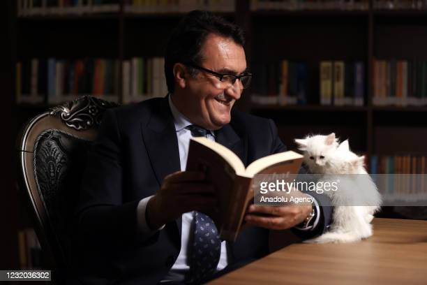 "Kittens sit on a hand of a library user as he reads a book at ""Kedili Tekke"" , used as a library at present in Bursa, Turkey on March 30, 2021. The..."