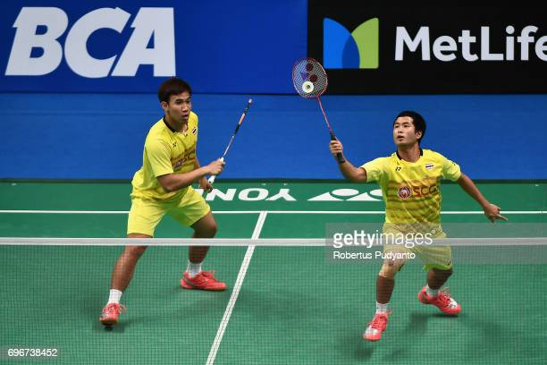Kittinupong Kedren and Dechapol Puavaranukroh of Thailand compete against Fajar Alfian and Muhammad Rian Ardianto of Indonesia during Mens Double...