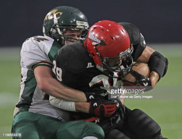 Kittson County Central vs WheatonHermanNorcross in 9Man semifinal game at the Dome 11/19/11 Kittson County Central's Tanner Lyberg pulled down...