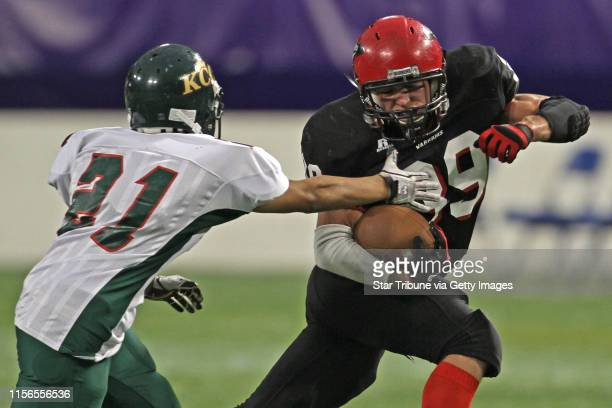 Kittson County Central vs WheatonHermanNorcross in 9Man semifinal game at the Dome 11/19/11 Kittson County Central's Robert Ryden defended as...