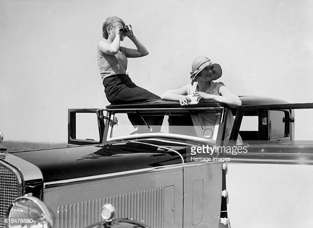 Kitty Brunell road testing a 1931 Delage D8. Delage D8 1931 4050 cc. Vehicle Reg. No. GP1230. Driver: Brunell, Miss. K. Place: Road test. Artist Bill...