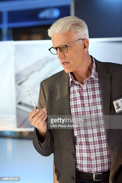 """Kitty"""" -"""" D.B. Russell holds up a wedding ring while he's in discussion in the lab about the murder of a prominent casino owner's wife, on CSI:..."""