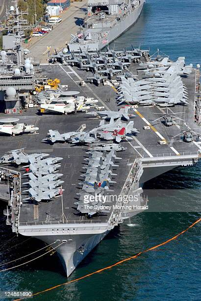 Kitty Hawk. FA18 Superhornets on the deck of the oldest-commissioned aircraft carrier in the United States' Naval Fleet, the USS Kitty Hawk, moored...