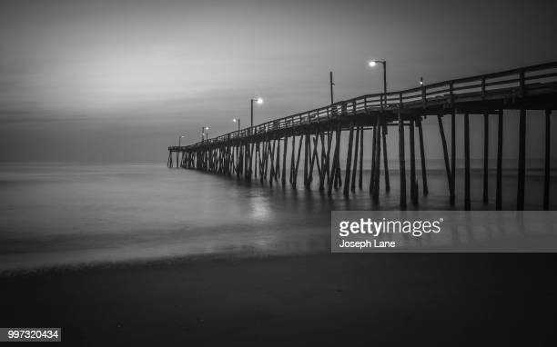 kitty hawk fishing pier - kitty hawk beach stock pictures, royalty-free photos & images