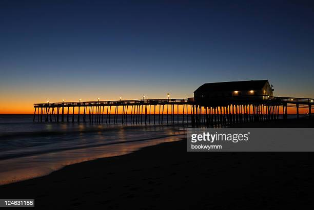 kitty hawk pier sunrise - kitty hawk beach stock pictures, royalty-free photos & images