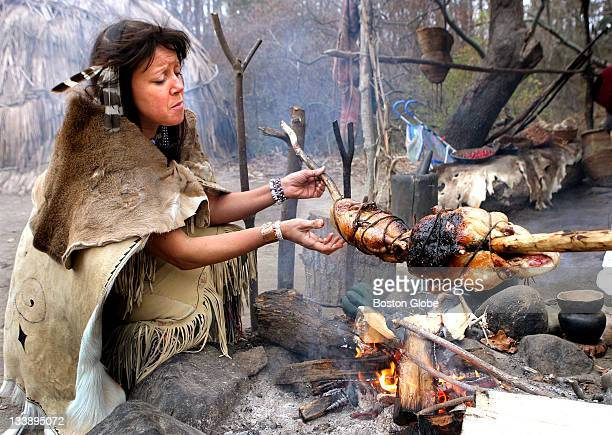 Kitty HendricksMiller of Mashpee a Wompanoag nativeAmerican turns ducks on a spit during a recreation at Plimoth Plantation of a Wompanoag harvest...