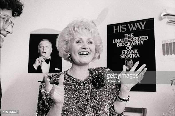 Kitty Kelly smiles at a book signing session for her new unauthorized biography of Frank Sinatra titled His Way
