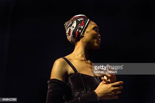Kitty Phetla senior soloist of the Joburg Ballet pauses on September 17 2014 in Johannesburg during a full dress rehearsal of the Nutcracker...
