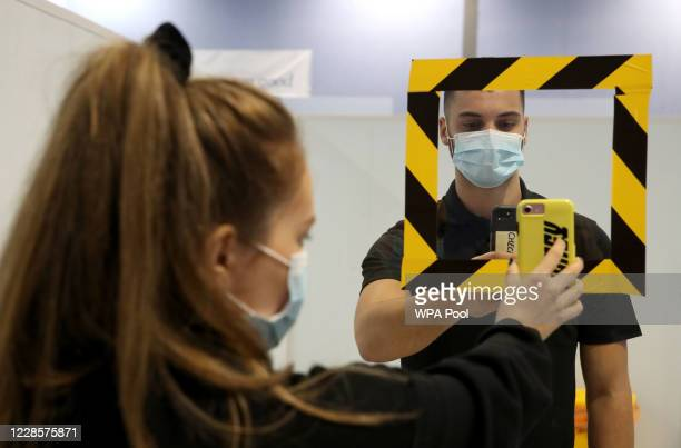 Kitty Ritchie has her QR code scanned on entry as she demonstrates how to take a coronavirus test at a new walk-through testing centre which will...