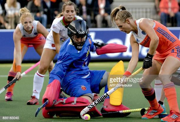 Kitty van Male of the Netherlands fights for the ball with goalkeeper Maria Ruiz of Spain during the women's Rabo EuroHockey Championships 2017 match...