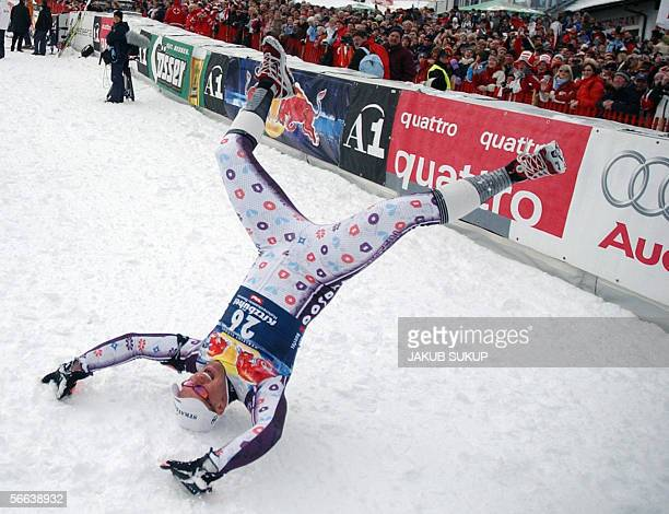 Marco Buechel of Lichstenstein celebrates his second place in the men's World Cup downhill event in the Austrian ski resort of Kitzbuhel 21 January...