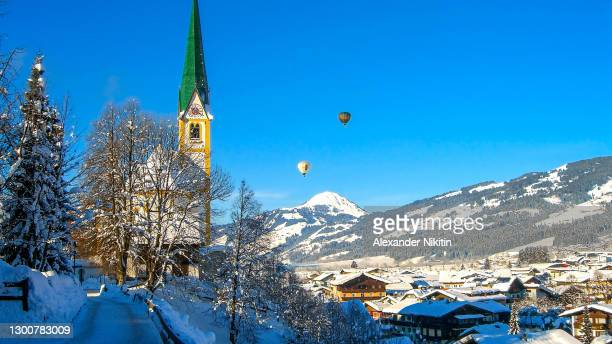 kitzbuhel in winter on a sunny day - austria stock pictures, royalty-free photos & images