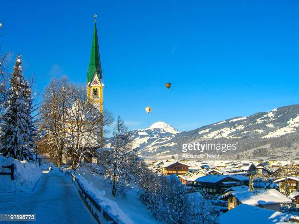 kitzbuhel in winter on a sunny frosty day, austria - kitzbühel stock pictures, royalty-free photos & images