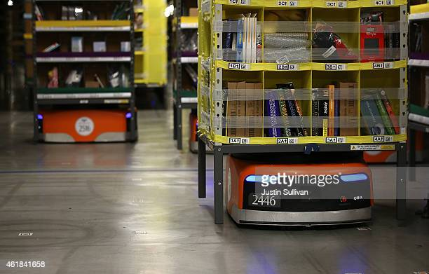 Kiva robots move racks of merchandise at an Amazon fulfillment center on January 20 2015 in Tracy California Amazon officially opened its new 12...