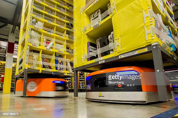 Kiva Systems LLC robots move shelves to fill orders at the Amazoncom Inc fulfillment center on Cyber Monday in Tracy California US on Monday Dec 1...