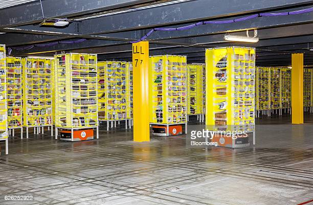 Kiva Systems LLC robots move shelves to fill orders inside an Amazoncom Inc fulfillment center in Robbinsville New Jersey US on Monday Nov 28 2016 In...