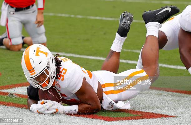 Kivon Bennett of the Tennessee Volunteers recovers a fumble by Stetson Bennett of the Georgia Bulldogs for a touchdown during the first half at...