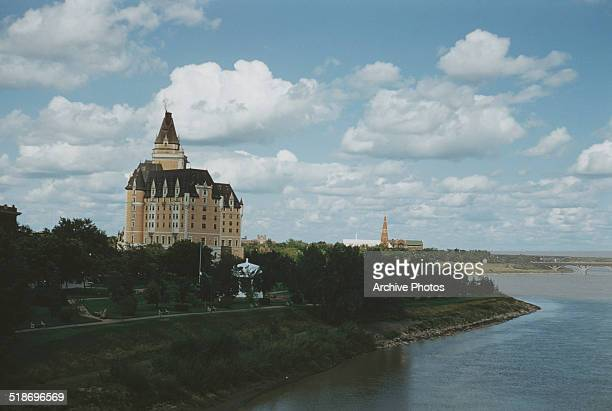 Kiwanis Park and the Bessborough Hotel on the South Saskatchewan River in Saskatoon Saskatchewan Canada circa 1960