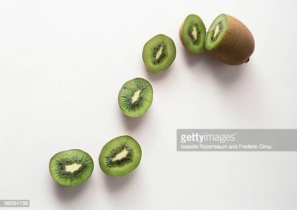 kiwi and kiwi slices - kiwi fruit stock pictures, royalty-free photos & images