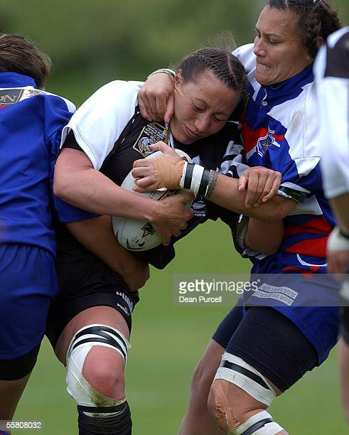 Kiwi Ferns player Karen Dougall gets caught by the Samoa defence during the 2002 Womens Rugby League World Cup match between the Kiwi Ferns and Samoa...