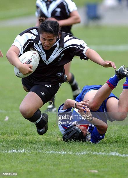 Kiwi Ferns player Maryanne Hemara runs over the Samoa defence during the 2002 Womens Rugby League World Cup match between the Kiwi Ferns and Samoa...