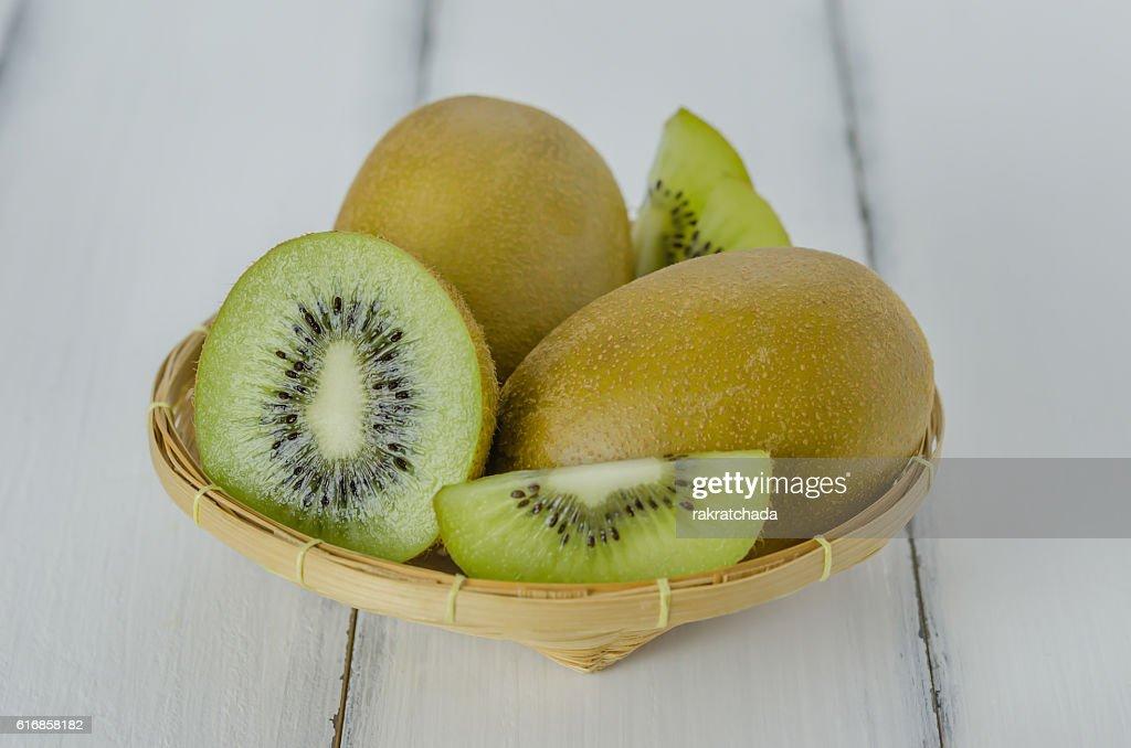 kiwi fruit and sliced with bamboo basket : Stock Photo