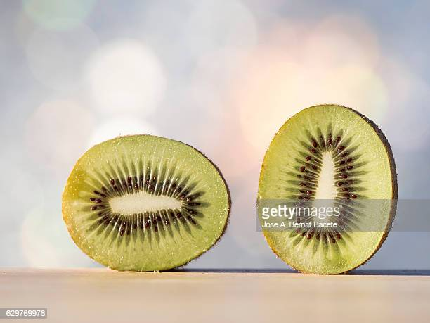 Kiwi fruit,  illuminated by the light of the Sun