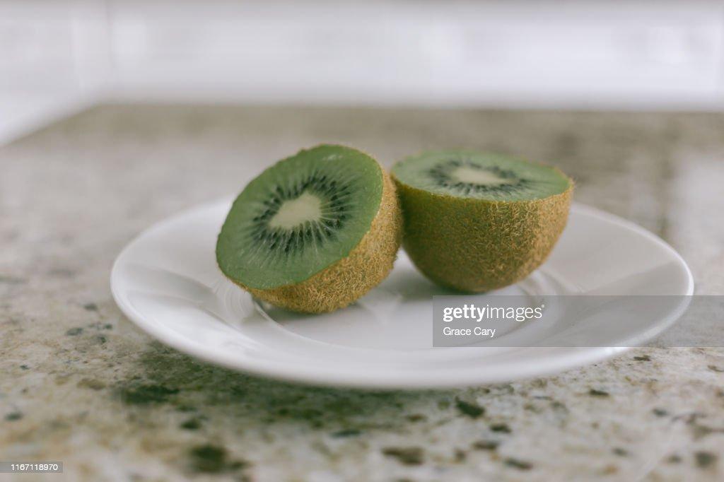 Kiwi Fruit on Saucer : Stock Photo