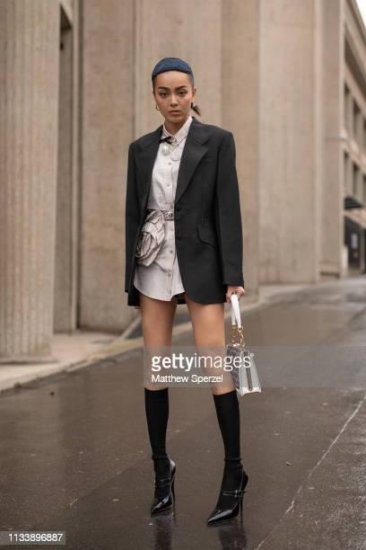 Kiwi Lee Han is seen on the street attending MIU MIU during Paris Fashion Week AW19 wearing MIU MIU on March 05, 2019 in Paris, France.