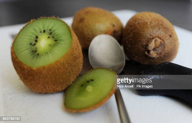 Kiwifruit also known as a Chinese gooseberry on a cutting board