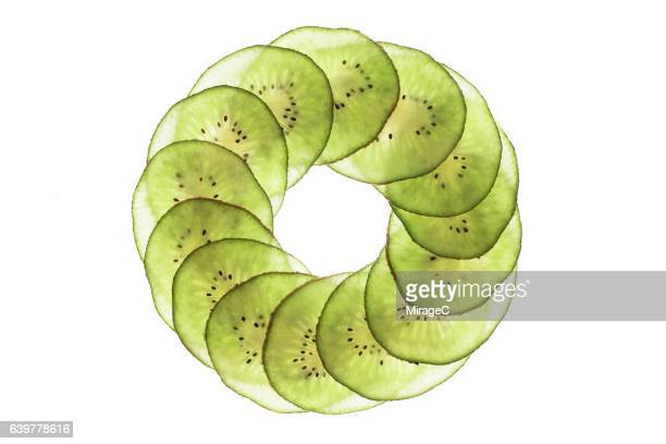 kiwifruit slices circle loop on white background - lightbox stock photos and pictures