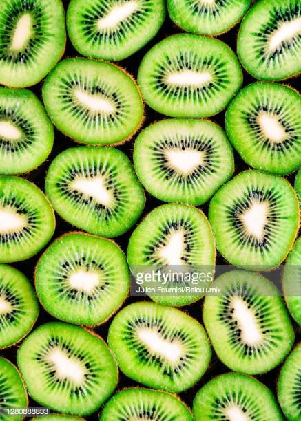 kiwis lined up, paris, france - kiwi fruit stock pictures, royalty-free photos & images