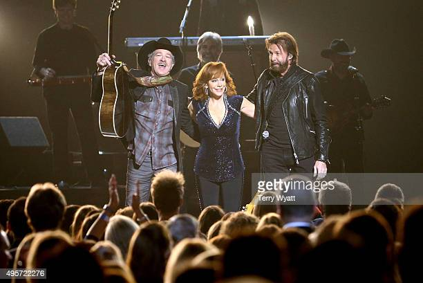 Kix Brooks and Ronnie Dunn of Brooks and Dunn and recording artist Reba McEntire perform onstage at the 49th annual CMA Awards at the Bridgestone...