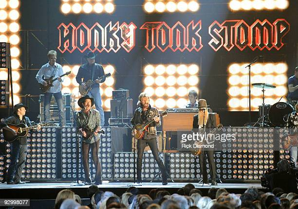 Kix Brooks and Ronnie Dunn of Brooks Dunn and Billy Gibbons perform onstage during the 43rd Annual CMA Awards at the Sommet Center on November 11...