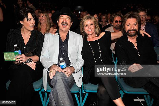Kix Brooks and wife Barbara with Ronnie Dunn and wife Janine pose during the 44th annual Academy Of Country Music Awards' Artist of the Decade held...