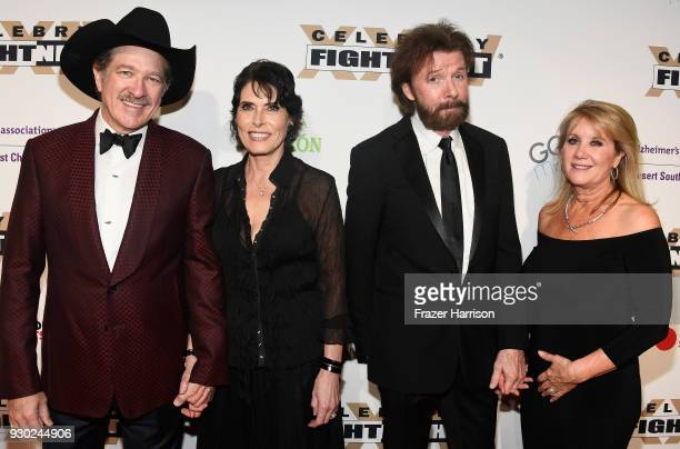 Kix Brooks Barbara Brooks Ronnie Dunn and Janine Dunn attend Celebrity Fight Night XXIV on March 10 2018 in Phoenix Arizona