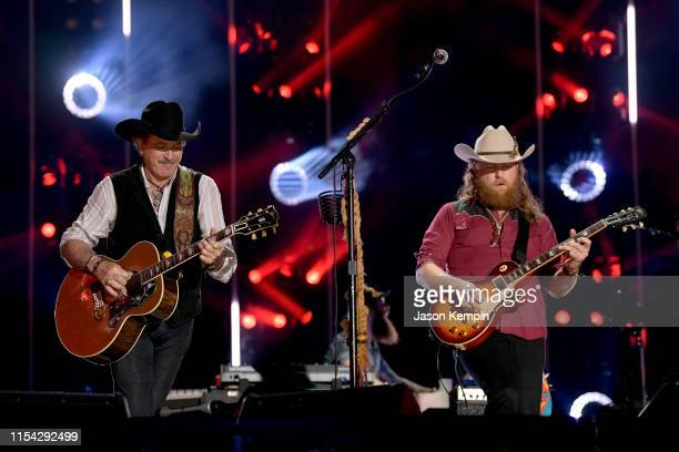 Kix Brooks of Brooks and Dunn and John Osborne of Brothers Osborne perform on stage during day 1 of 2019 CMA Music Festival on June 06 2019 in...